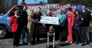 TPSF members presenting a check for $3,308 to Operation Homefront Georgia following TPSF V in 2013